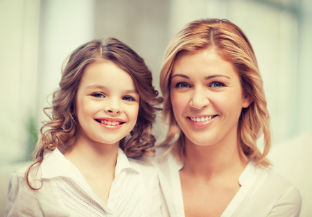 bright closeup picture of mother and daughter photo