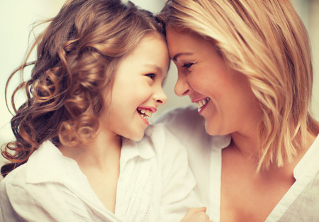 mid teens: bright picture of hugging mother and daughter Stock Photo