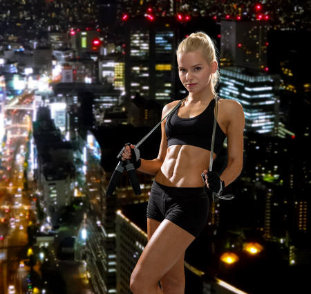 6 pack: sport, exercise and healthcare - sporty woman with skipping rope