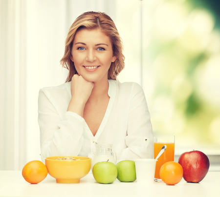 picture of woman in casual clothes with healthy breakfast photo