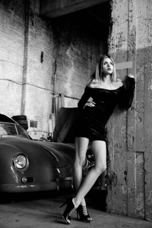 picture of fashionable woman in retro garage photo