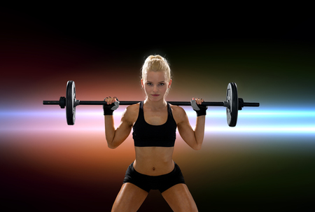 body pump: fitness, sport and dieting concept - sporty woman exercising with barbell Stock Photo