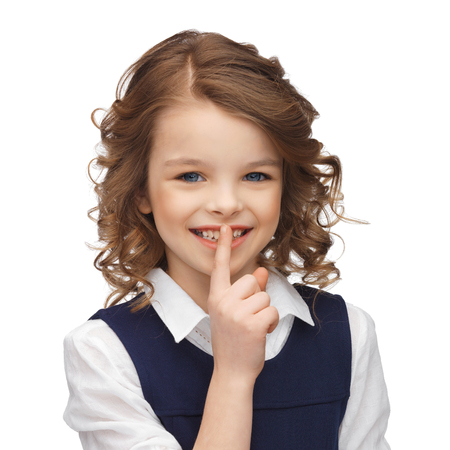 pre adolescent girl: happy children and gestures concept - picture of beautiful pre-teen girl showing hush gesture