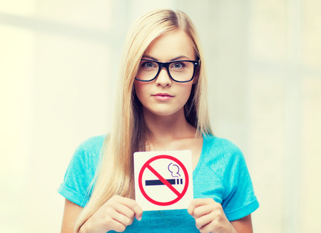 card stop: picture of woman with smoking restriction sign