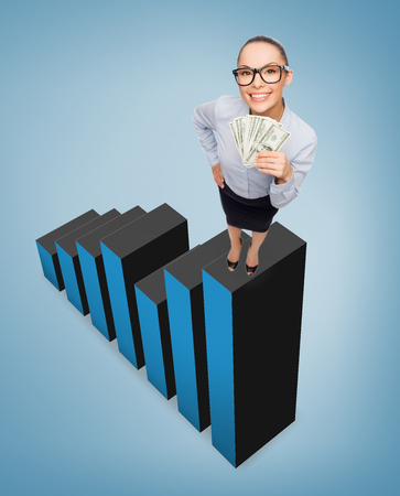business, money and banking concept - smiling businesswoman in eyeglasses with dollar cash money standing on growing chart photo