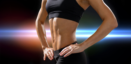 six girl: fitness and diet concept - close up of beautiful athletic female abs in sportswear
