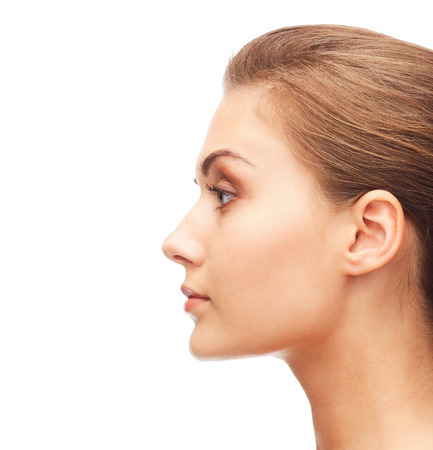 beauty and health concept - profile portrait of young woman photo