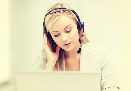 call center agent: female helpline operator with headphones and laptop