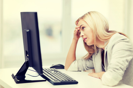 dilemma: picture of stressed businesswoman with computer at work