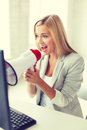 picture of crazy businesswoman shouting in megaphone photo