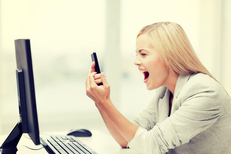 picture of angry woman shouting at phone photo