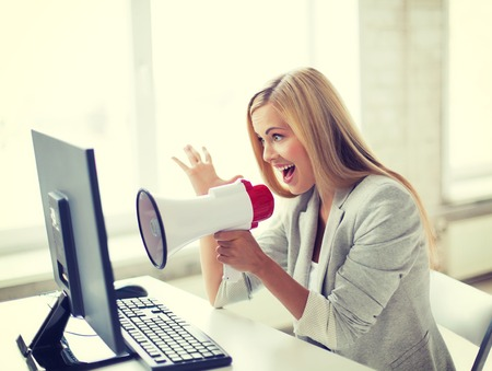 woman screaming: picture of crazy businesswoman shouting in megaphone Stock Photo