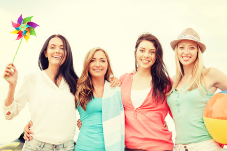 summer holidays, vacation and beach activities concept - smiling girls having fun on the beach Stock Photo - 30324811