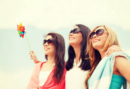 summer holidays, vacation and beach activities concept - smiling girls in shades having fun on the beach Stock Photo - 30324813