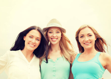 summer holidays and vacation concept - group of smiling girls chilling on the beach Stock Photo - 30324835