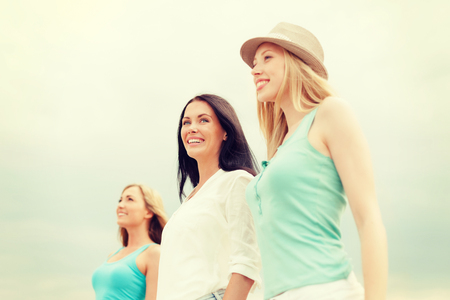 summer holidays and vacation concept - group of smiling girls chilling on the beach Stock Photo - 30324862