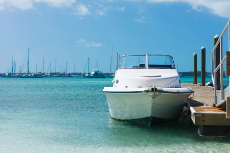 vacation, travel and sea concept - white boat at blue sea photo