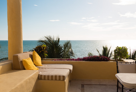 hotel lounge: vacation, home and travel concept - sea view from balcony of home or hotel room Stock Photo