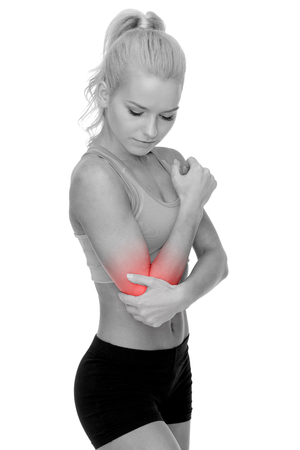 arm pain: healthcare, fitness and medicine - sporty woman with pain in elbow Stock Photo