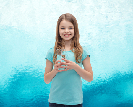 preteen  pure: health and beauty concept - smiling little girl with glass of water