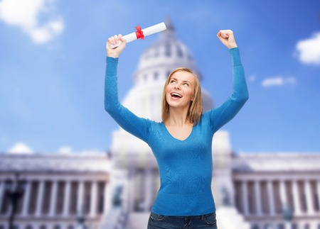 master degree: university and education concept - smiling woman with diploma