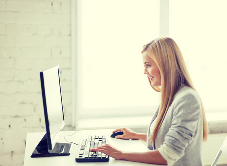 computer networking: picture of smiling businesswoman with computer in office