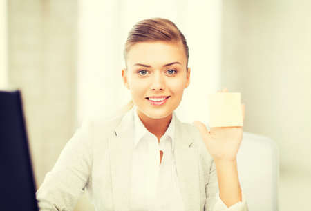 job posting: picture of smiling businesswoman showing sticky note Stock Photo