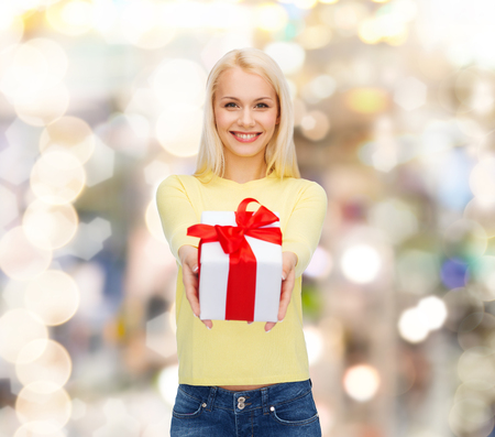 little girl surprised: holidays, love and happiness concept - beautiful girl with gift box