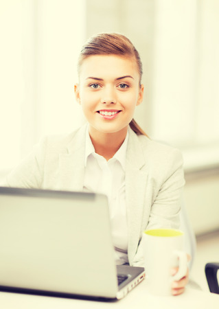 hot girl: picture of smiling businesswoman with laptop in office