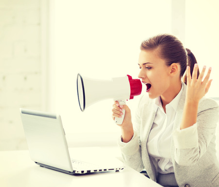 picture of strict businesswoman shouting in megaphone photo