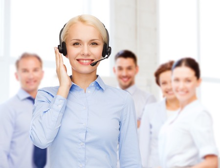 representative: business, technology and call center concept - friendly female helpline operator with headphones