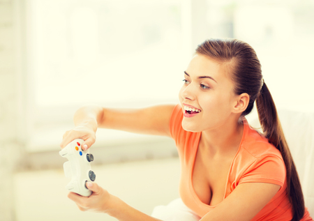 gamer: picture of happy woman with joystick playing video games Stock Photo
