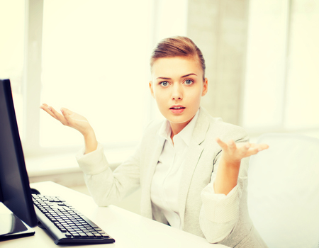 business concept - stressed businesswoman with computer in office photo