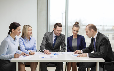 business and office concept - business team with documents having discussion in office