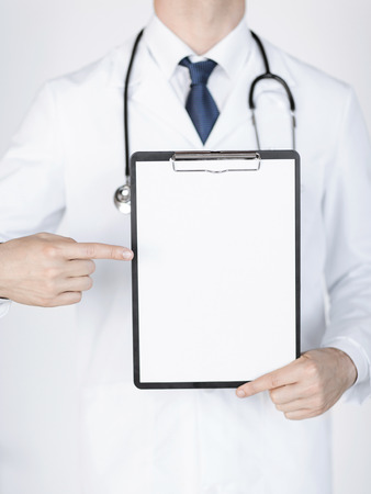 contact sheet: close up of doctor pointing at blank white paper