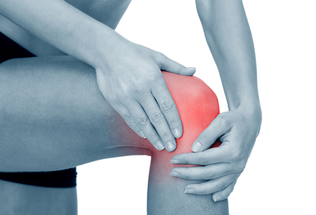 fitness, healthcare and medicine concept - close up of female hands holding knee Stock Photo