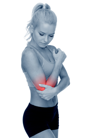 elbow pain: healthcare, fitness and medicine - sporty woman with pain in elbow Stock Photo