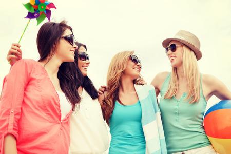 weekend activity: summer holidays, vacation and beach activities - girls having fun on the beach Stock Photo