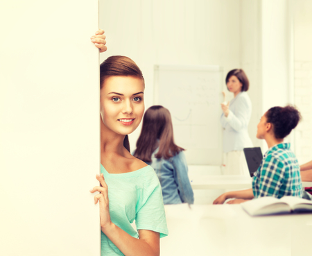 education concept - smiling student girl with white blank board photo