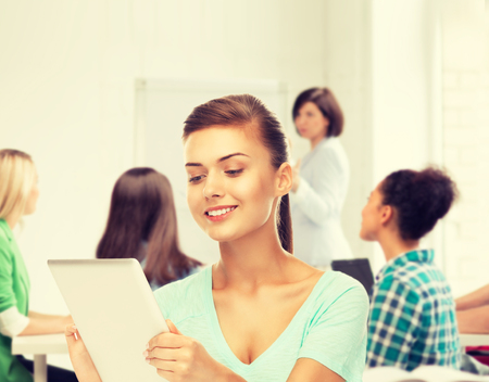 education and internet concept - student with tablet pc in college photo