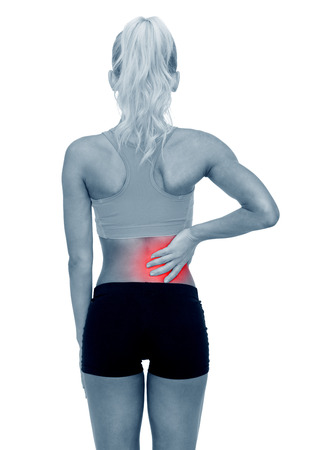 sport injury: fitness, healthcare and medicine concept - sporty woman touching her back