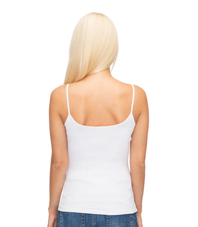 shirt design and people concept - young woman in blank white tank top from back Imagens
