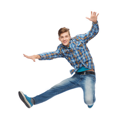 air jump: happiness, freedom, movement and people concept - smiling young man jumping in air