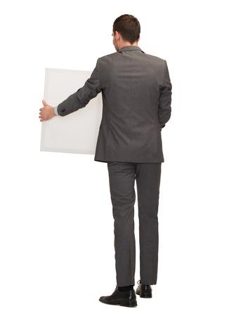personas de espalda: negocios, la educación y la oficina concepto - hombre de negocios o profesor con la tarjeta blanca grande de la parte posterior