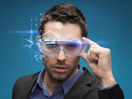 futuristic man: future, technology, business and people concept - handsome businessman in virtual glasses Stock Photo
