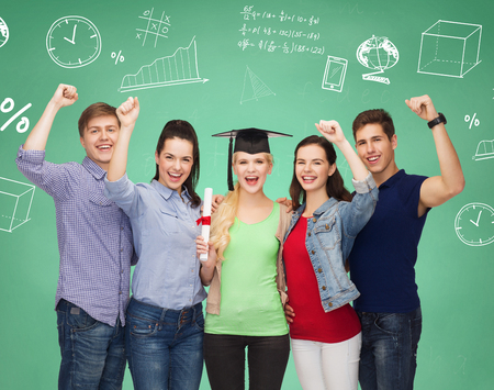 high school graduation: education, friendship, graduation, gesture and people concept - group of smiling students standing over green board