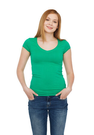 green clothes: happiness and people concept - smiling teenage girl in casual clothes Stock Photo
