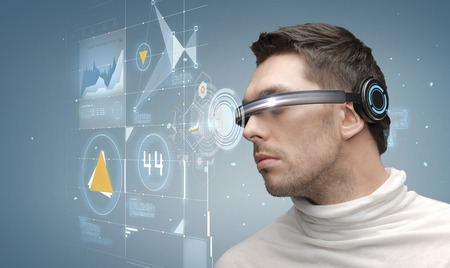 sci fi: future, technology, business and people concept - man in futuristic glasses