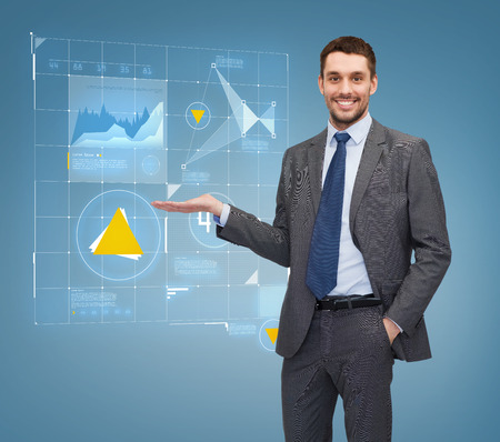business, office, advertising and people concept - businessman showing virtual screen with graphs photo