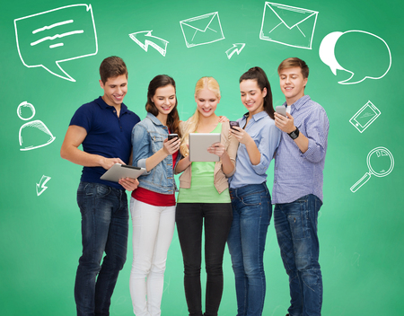new: friendship, communication, connection and technology concept - group of smiling students with tablet pc computers and smartphones